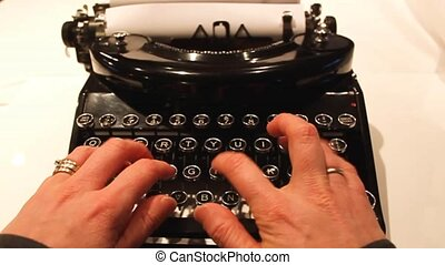 an old fashioned noiseless typewriter with antique looking keys, black and silver trim.