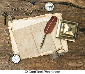 antique office supplies and accessories on wooden table