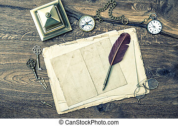 antique office supplies and writing accessories on wooden backgr