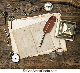Antique office supplies and writing tools on wooden desk