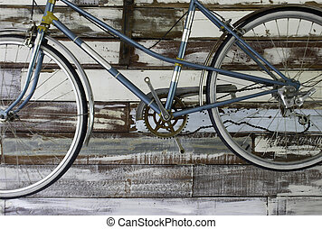 Antique old bicycle on the wall