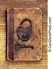 Antique Padlock with key on old book