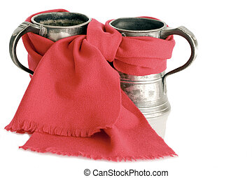 Antique pewter ale tankards with red scarf