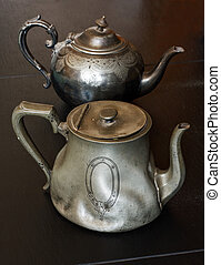 european traditional pewter teapots you might find in an antiques store or auction