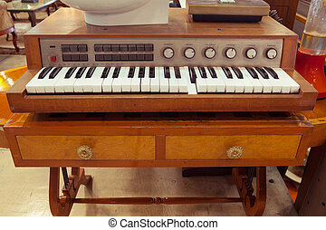 Antique piano keys and wood grain