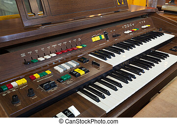 Antique piano keys and wood grain