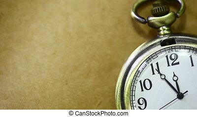 Antique pocket Watch - An antique pocket watch ticking, on a...