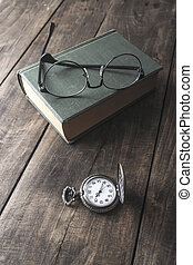 Antique pocket watch, glasses and book