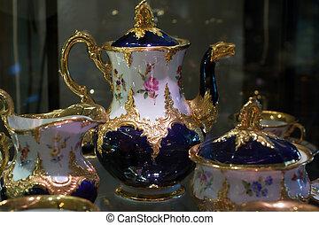 Antique porcelain coffee set in show case