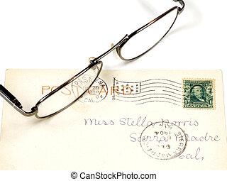 Antique postcard and eyeglasses