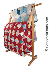 Antique Quilts On Wooden Rack. - Antique quilts on a wooden...