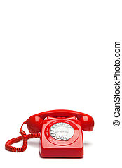 Antique red phone on a white background