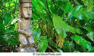 Antique Religious Statue in a Bornean Village. 1080p FullHD...