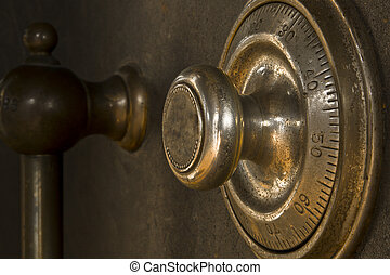 Close-up of a combination dial on an antique safe.