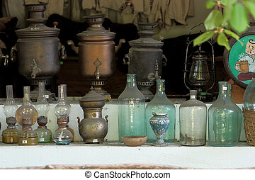 The exhibition and the market of old items samovars glass bottles petrol lamps clothes