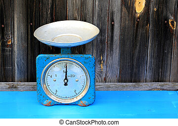 antique scales on the old wooden background vintage retro