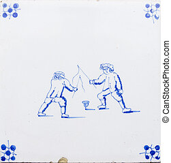 Image of two boys with hats and 17th century clothes playing with a top