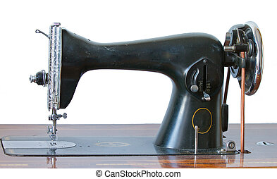 Antique sewing machine on white - Antique black sewing...