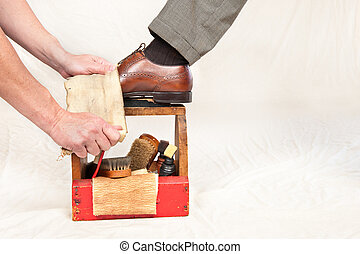 Antique shoe shine box and worker - A man gets his shoes ...