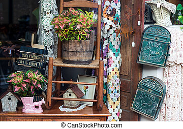 Antique shop window with various odds & ends