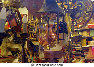 Antique shop with old metal things at norwegian market in Bergen