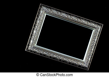 Antique silver and patterned picture frame black background