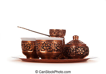 Antique silver pitcher and coffee cup set with dates in a tray isolated on a white background, Turkish coffee set isolated on white.