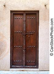 Antique small wooden door