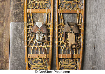 Antique Snowshoes on Rustic Cabin Wall
