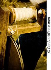 antique spinning machine close up