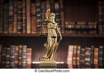 Antique statue of justice, law, books background