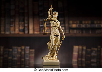 Judge gavel and scales of justice and book background