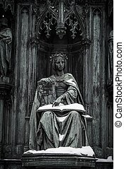 Antique statue with book