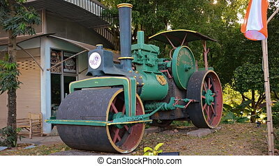 Antique steam roller on static display at a public park