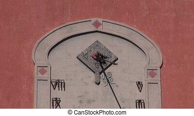 Antique sun clock sundial on wall