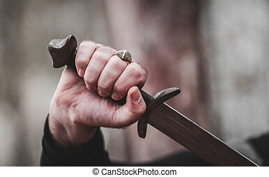 sword in the man's hand