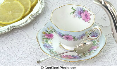 Antique Tea Cup - Pouring tea into an antique tea cup