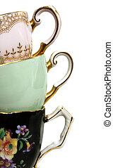 Antique Teacup Handles - Three antique teacups stacked with...