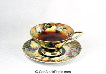 teacup with tea - antique teacup with tea