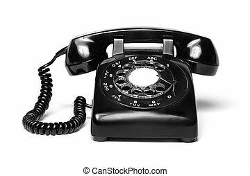 1960s style antique black telephone isolated on white