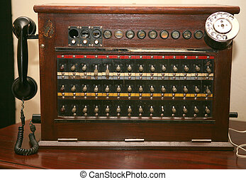 An antique telephone switchboard of the kind used in hotels and companies in the mid-20th century.