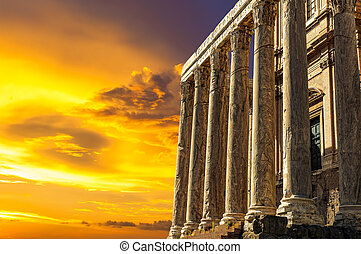 Antique Temple of Antoninus and Faustina in the Roman Forum at sunset
