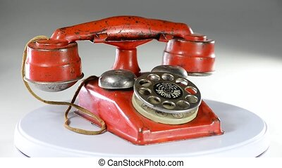 Antique Toy Telephone. - Red toy telephone made in the...