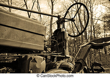 Antique Tractor in Sepia - Looking up from the side at an ...