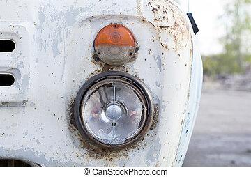 Antique truck grille and broken headlight