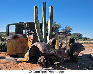 Antique truck with cactus - Derelict truck overgrown with...
