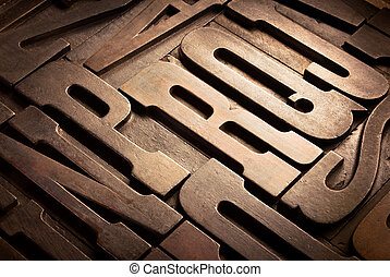 antique type - old wooden uppercase type in perspective