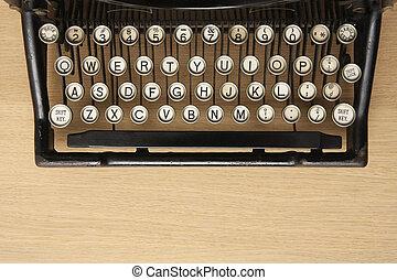 Antique typewriter on a wooden desk - Retro typewriter with...
