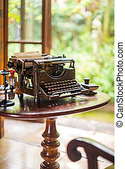 Antique typewriter on table by the window.