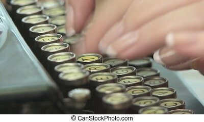 Antique Typewriter - Woman types on vintage typewriter